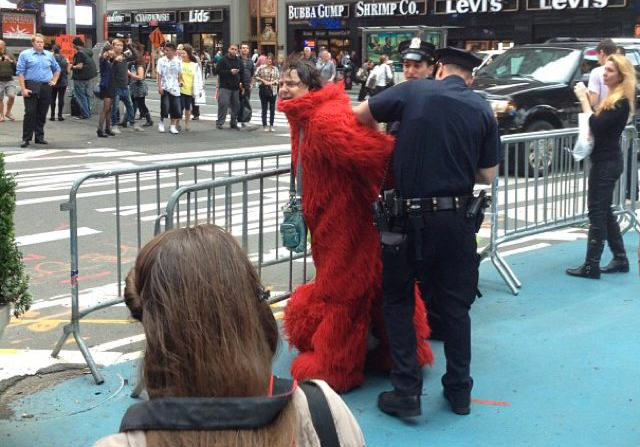 201209 elmo1 Times Square Elmo Arrested For Being Racist As F*ck