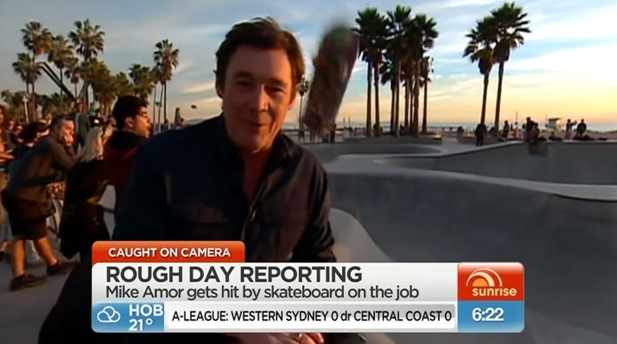 267 News Reporter Perfectly Headshotted By Flying Skateboard