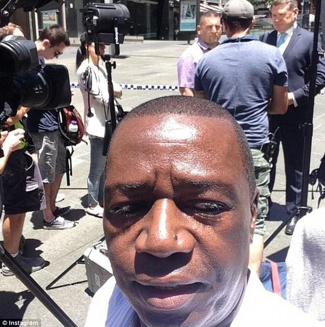 240F524800000578 0 image a 4 1418629129245 People Are Taking Selfies Outside The Terror Siege Thats Happening In Sydney