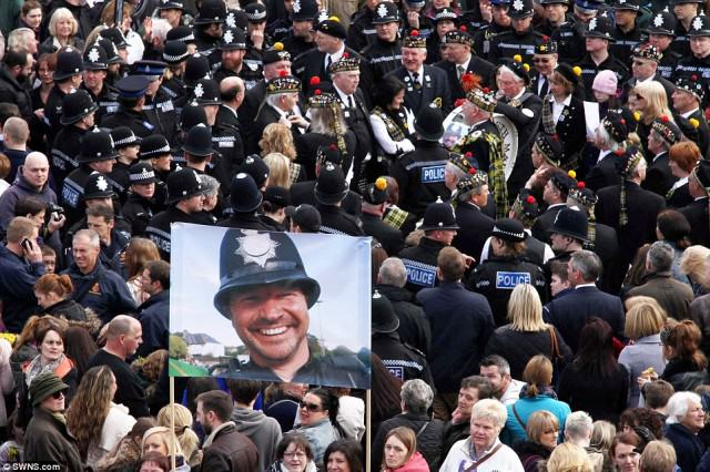 police 4 640x426 Hero Policemans  Death Sees Thousands Line The Streets For Final Beat Walk