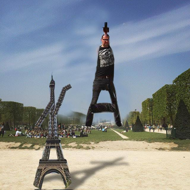 72 This Guy Posing Next To The Eiffel Tower Is The Latest Internet Craze