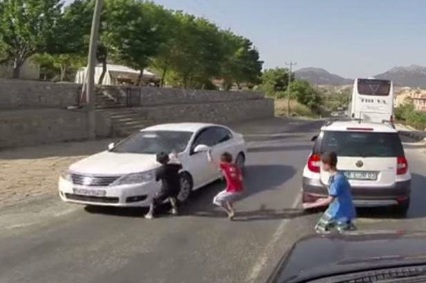road Kid Playing Chicken In Middle Of Road Hit And Dragged By Car