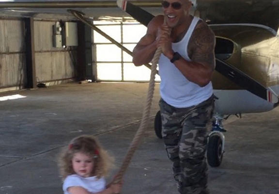 The Rock Pulls Entire Plane, Makes Little Kid Think Shes Doing It All By Herself dj web