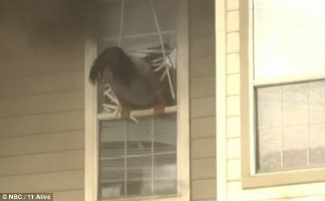 firewin2 Two Girls Caught On Camera Being Forced To Jump Through A Window To Escape House Fire