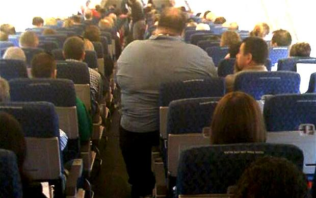 k8Jabmlyk1.jpg Airplane Passenger Sues For Back Injury   Caused By Sitting Next To Obese Man