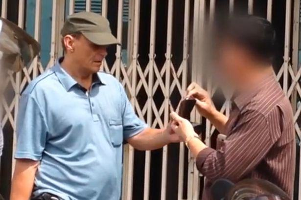 UNILAD Michael Jones photograhed in Cambodia 13 British Paedophile Locked Up After Being Pictured Holding 11 Year Olds Hand