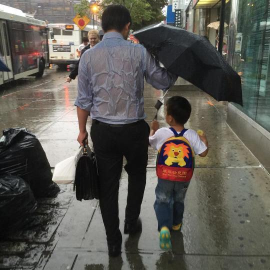 UNILAD dad umbrella 17 The Story Behind That Photo Of The Dad Sheltering His Son From The Rain