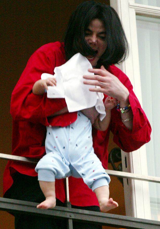 Michael Jackson dangles his son Prince Michael II over a balcony Woman Jailed For Holding Baby Out Of Window Screaming Wacko Jacko!