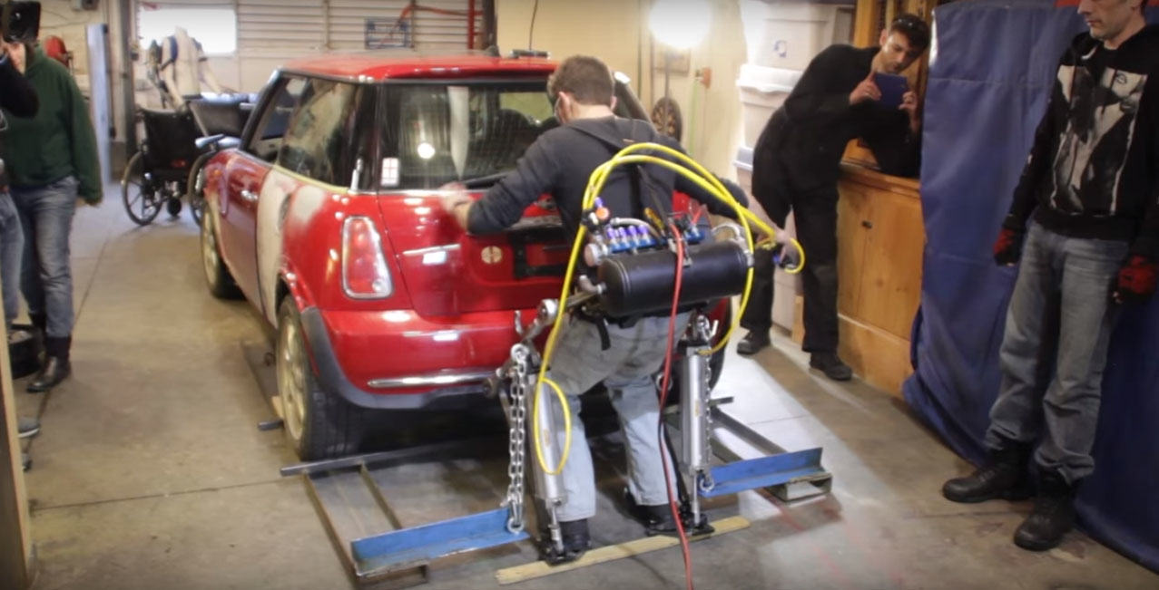 2 6 Guy Builds Incredible Exoskeleton That Lets Him Workout With A Car