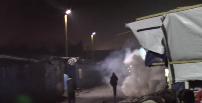 Screen Shot 2016 01 25 at 10.53.49 Banksy Reveals New Artwork Criticising Use Of Teargas In Calais Refugee Camp