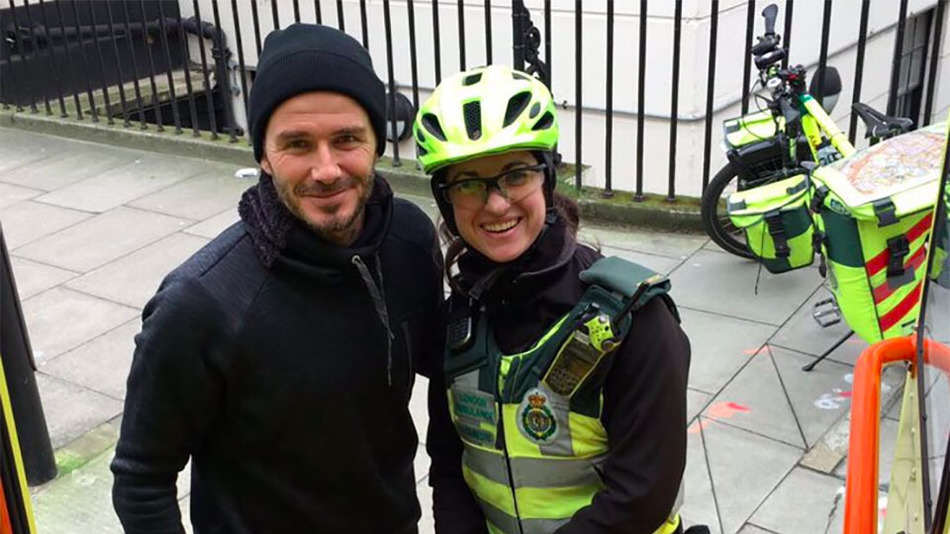 David Beckham helping paramedic David Beckham Stops To Help Paramedic With Injured Elderly Man
