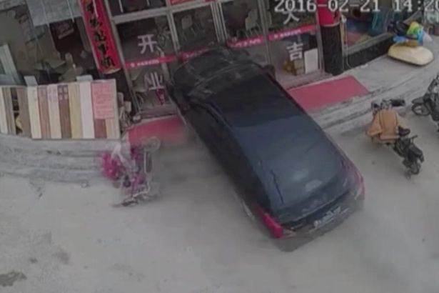 Car smashes through burger restaurant in China Shocking Moment Car Crashes Through Restaurant And Traps Young Girl