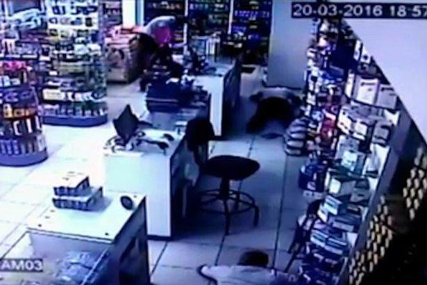 Terrifying Moment Toddler Wanders Into Middle Of Armed Robbery robber2