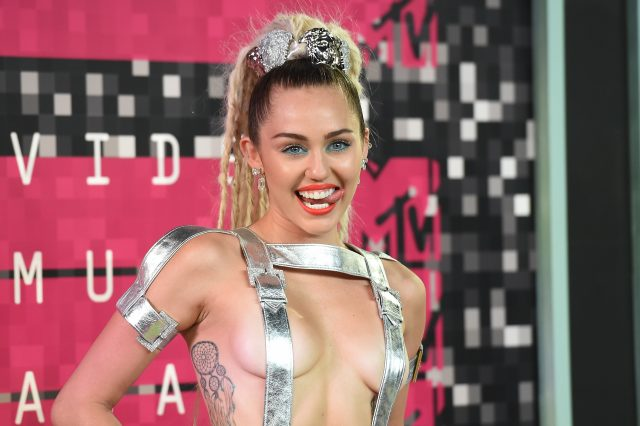 GettyImages 486124812 640x426 The Internets Losing Its Sh*t Over Miley Cyrus New Tattoo F*ck Up