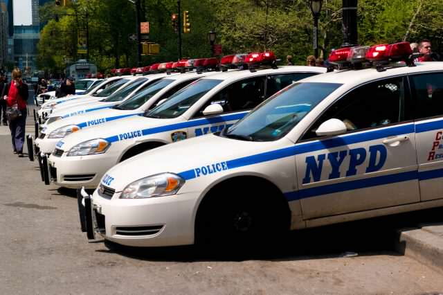 NYPD cars line up 640x426 Cop Suspended After Brutal Video Shows Him Threatening Onlookers With Gun
