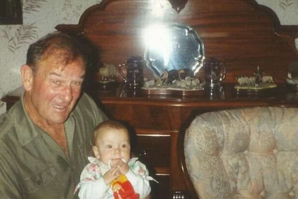 Kimberley with her granddad Ken in the living room at Stott Hall Farm Woman Reveals What Growing Up In House In Middle Of M62 Was Like