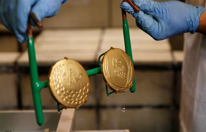 1467191380 worker casa da moeda do brasil brazilian mint takes out gold plated rio 2016 olympic This Is How Much Olympic Gold Medals Are Actually Worth