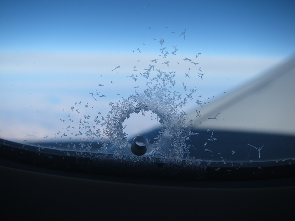 6409916819 21dd2505df b Heres What The Tiny Holes In Airplane Windows Are For