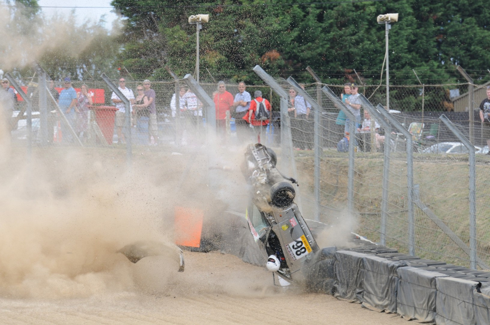 Incredible Moment Racing Driver Survives Crash With Head Out Of Window SWNS CRASH ROLL 10