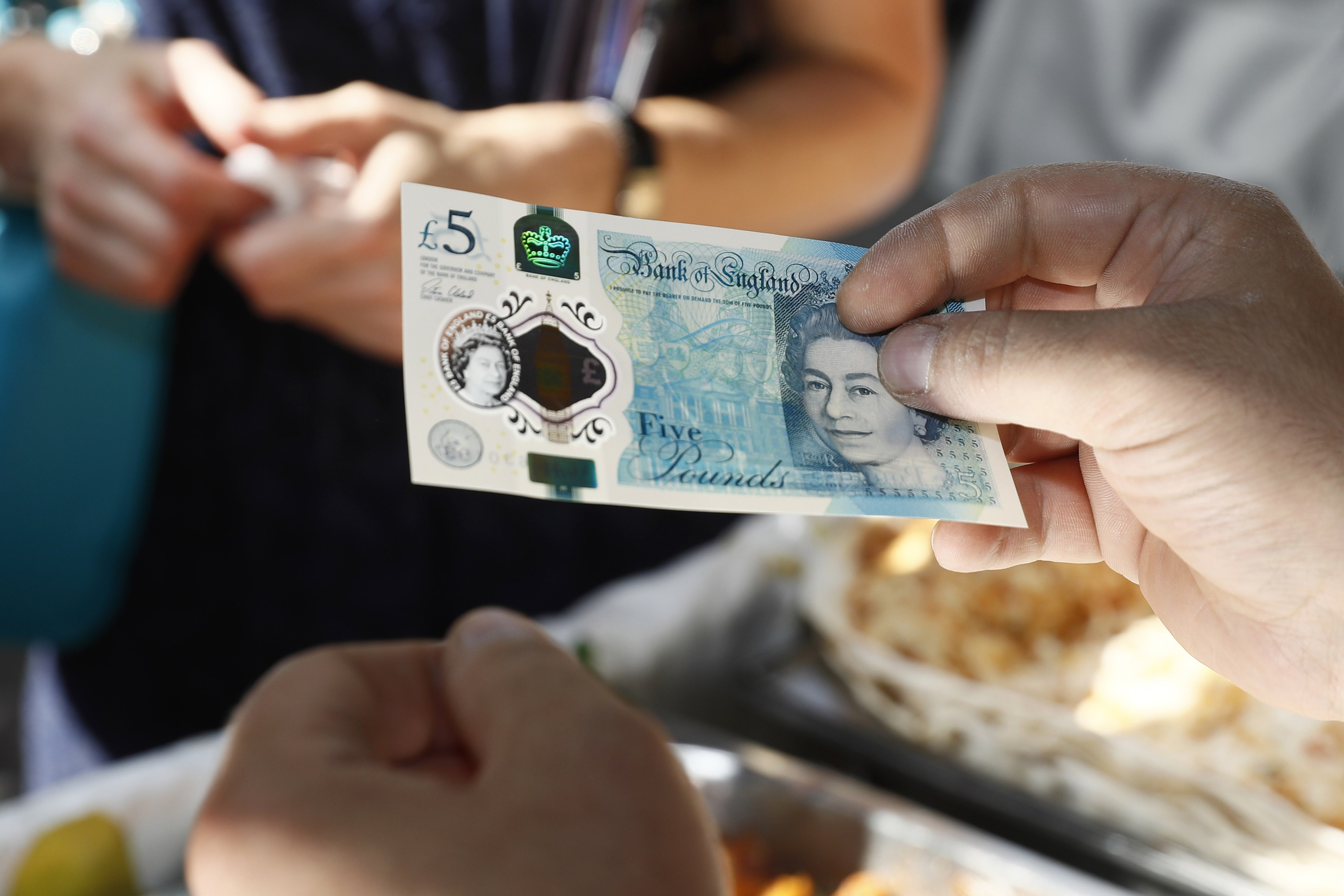 GettyImages 603974050 Shining A Laser Through The New Fiver Reveals Something Pretty Cool