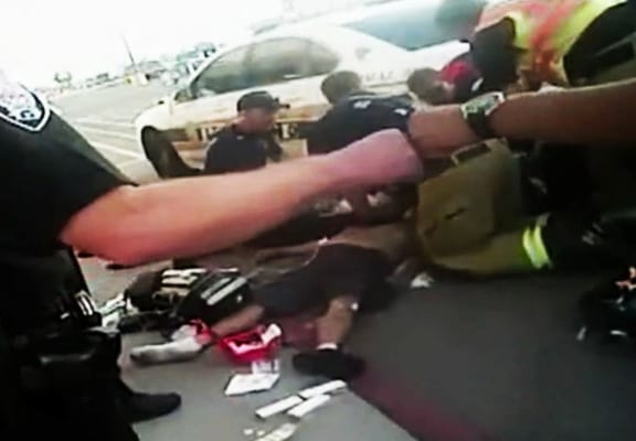 Cops Fist Bump Each Other While Man Dies Being Restrained