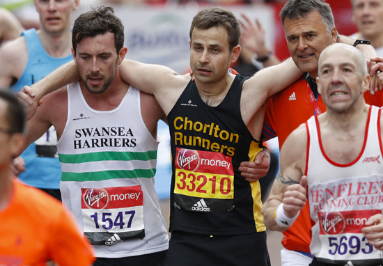 Heartwarming Moment Marathon Runner Helped Over Line By Fellow Competitor